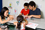 teenage volunteers working with young children at summer academy for children with special needs  horizontal