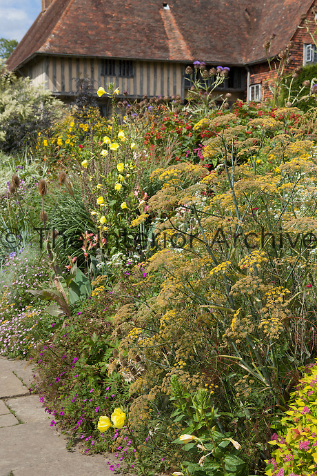 View of Great Dixter house looking over the Long Border