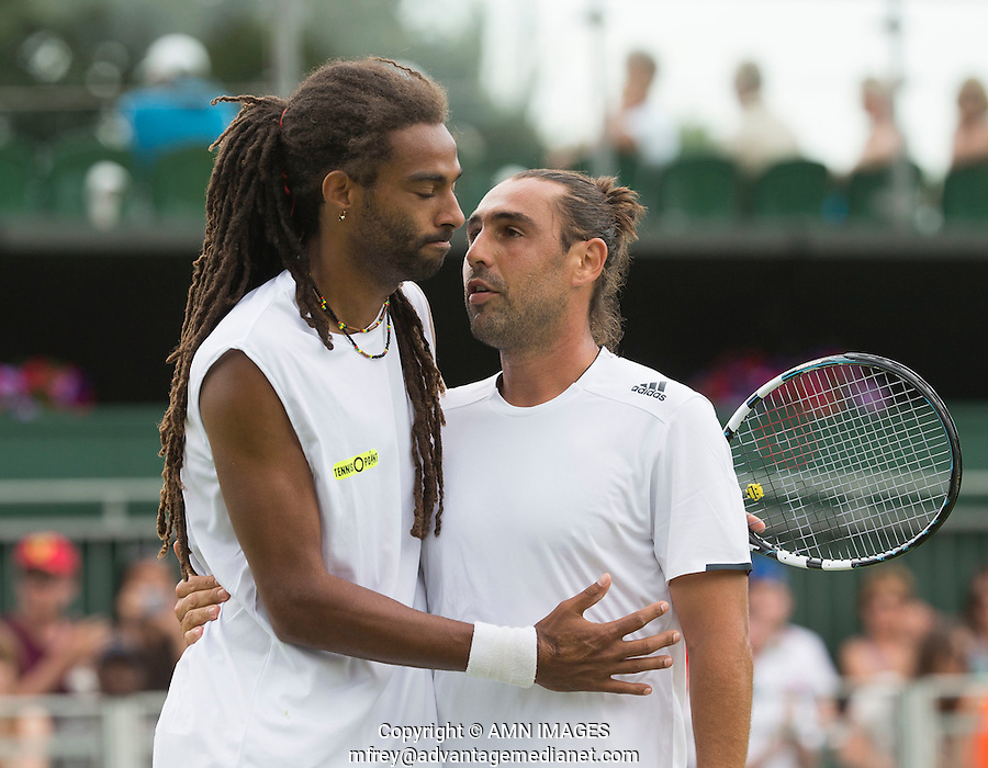 MARCOS BAGHDATIS (CYP), DUSTIN BROWN (GER)<br /> <br /> The Championships Wimbledon 2014 - The All England Lawn Tennis Club -  London - UK -  ATP - ITF - WTA-2014  - Grand Slam - Great Britain -  23rd June 2014. <br /> <br /> &copy; AMN IMAGES