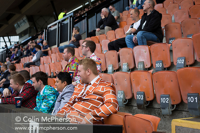 Spectators in a crowd look on as Edinburgh City take on Berwick Rangers at Meadowbank stadium. The match ended in another defeat for the newly-promoted team from the capital. Despite taking the lead in the 66th minute through Ousman See's goal, City lost the game 2-1, watched by a crowd of 410 and remained without a point at the foot of the table after four League games.
