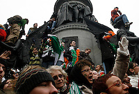 The crowd reacts to the annual St. Patrick's Day parade on O'Connell Street.