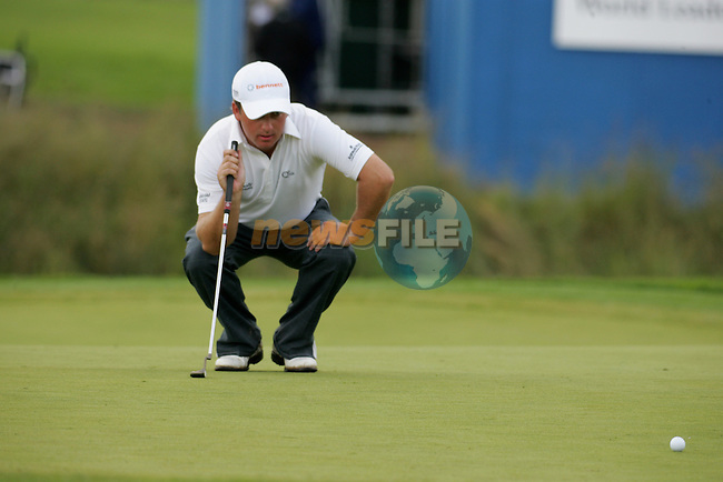 Day 4 of the Smurfit Kappa European Open in the K Club in Straffin Co Kildare Ireland. 8/7/07.Graham McDowell playing his thired shot after putting his tee shot in the water on the 18th during the final round of the Smurfit Kappa European Open...Photo: Newsfile/Fran Caffrey.