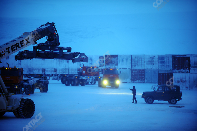 At the Kupol gold mine in Chukotka operated by the Canadian company Kinross, in the early morning trucks were loaded with containers. Russian Far East, February 8, 2011