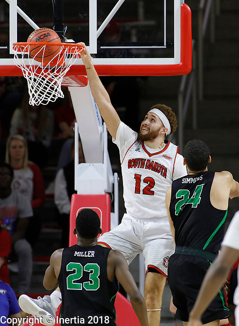 VERMILLION, SD: MARCH 14:  Trey Burch-Manning #12 of South Dakota dunks after a fast break past Zachary Simmons #24 and Michael Miller #23 of North Texas during the 2018 CBI Basketball Tournament at the Sanford Coyote Sports Center in Vermillion, S.D.  (Photo by DIck Carlson/Inertia)