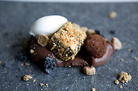 A biscuit and chocolate dessert. Fine dining food served in Les Cols, a MIchelin-starred restaurant and hotel owned by chef Fina Puigdevall