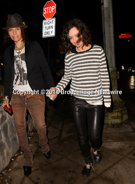 Pictured: Linda Perry, Sara Gilbert<br /> Mandatory Credit: Luiz Martinez / Broadimage<br /> Annie Leibovitz Book Launch - Outside Arrivals<br /> <br /> 2/26/14, West Hollywood, California, United States of America<br /> Reference: 022614_LMLA_BDG_095<br /> <br /> sales@broadimage.com<br /> Bus: (310) 301-1027<br /> Fax: (646) 827-9134<br /> http://www.broadimage.com