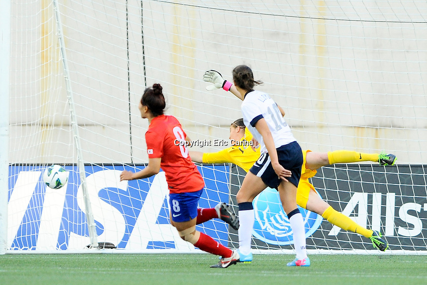 Korea Republic midfielder Cho Sohyun (8) shoots and scores on US Women's National goalkeeper Nicole Barnart (18) in action during the International Friendly soccer match between the USA Women's National team and the Korea Republic Women's Team held at Gillette Stadium in Foxborough Massachusetts.   Eric Canha/CSM