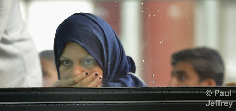 A woman looks out from a special bus that takes refugees from the border crossing at Beremend, along Hungary's border with Croatia, to a nearby train station in order to continue their journey through Hungary and into Austria. Hundreds of thousands of refugees and migrants flowed through Hungary in 2015 on their way to western Europe from Syria, Iraq and other countries.