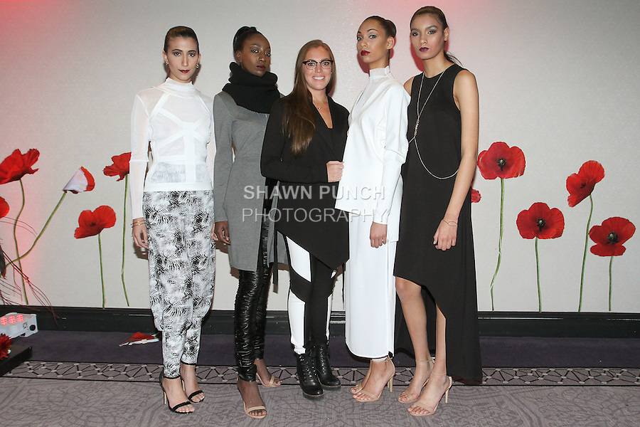 Canadian fashion designer Amanda Maria Matthew (center) poses with models after her Amanda Maria Fall Winter 2016 collection fashion show, at the Pret-A-Porter Fall Winter 2016 runway show for Fashion Gallery New York Fashion Week on February 14, 2016, during New York Fashion Week Fall 2016.