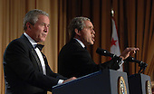 United States President President George W. Bush (L) and his inner self monologue, played by Steve Bridges, entertain guests at the White House Correspondents' Association Dinner in Washington on April 29, 2006.   .Credit: Roger L. Wollenberg - Pool via CNP.