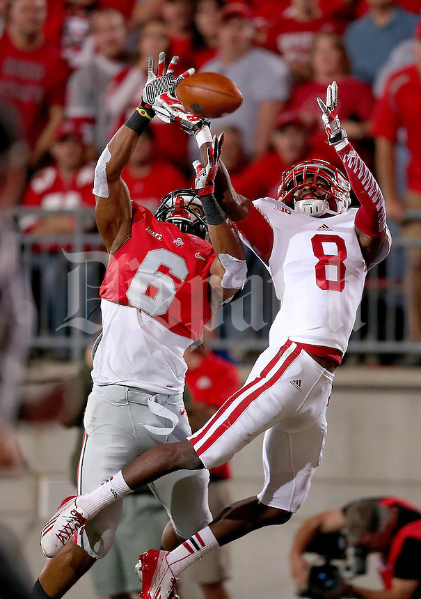 Ohio State Buckeyes wide receiver Evan Spencer (6) and Wisconsin Badgers cornerback Sojourn Shelton (8) go up for what became an incompletion during the first half of the game between Ohio State and Wisconsin at Ohio Stadium on Saturday, September 28, 2013. (Columbus Dispatch photo by Jonathan Quilter)