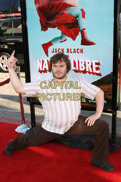 "JACK BLACK.Arrivals - World Premiere of ""Nacho Libre"" .held at Grauman's Chinese Theatre, .Hollywood, Los Angeles, California, .USA,12 June 2006..full length funny bending legs pose gesture arm finger up gesture.Ref: ADM/ZL.www.capitalpictures.com.sales@capitalpictures.com.©Zach Lipp/AdMedia/Capital Pictures."