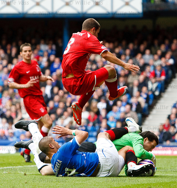 Madjid Bougherra slides in on Aberdeen keeper Jamie Langfield and is sent off on the decision of the linesman