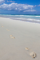 Footprints in the white sand beach near Tulum, Mexico