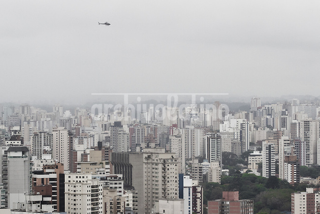 "Sao Paulo 17/10/2011.A Helicopter lands at the top of the Tivoli hotel in Sao Paulo to pic up a passanger heading to a major city conference center, near by Peulista Avenue the hotel is located in a major ""helicopers avenues"", corridors used by helicopters to fly in a orderly manner around town. Sao Paulo is home to the biggest fleet of privete helicopters in the wolrd..This helicopter belongs to Helipark, one of the biggest opperators in the city..Fotos: Fernando Cavalcanti"