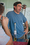 Stone Barn Brandyworks, a micro-distillery in SE Portland, Oregon run by Sebastian and Erica Degens.  They make products that include rye whiskey, pear brandy, and other varieties of distilled spirits and operate out of a very small, green warehouse space.  Their products are not yet for sale other than directly from them.  Sebastian Degens offering up a Saturday afternoon tasting in their warehouse.