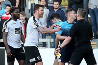 Referee Scott Jackson gets ready to show Woking's Paul Hodges a yellow card during Dartford vs Woking, Vanarama National League South Football at Princes Park on 23rd February 2019