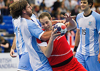05 APR 2012 - LONDON, GBR - Great Britain's Simon Witlin (GBR) (#9, in red and blue) finds his path to goal blocked by Argentina's Agustin Vidal (#14, in white and light blue) during the men's 2012 London Cup match at the National Sports Centre in Crystal Palace, Great Britain (PHOTO (C) 2012 NIGEL FARROW)