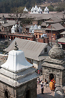 Pashupatinath, Kathmandu, Nepal.  Votive Shrines, Chaityas, Funeral Monuments, Memorials Overlooking the Temple (far right, out of view) on the other side of the Bagmati River.