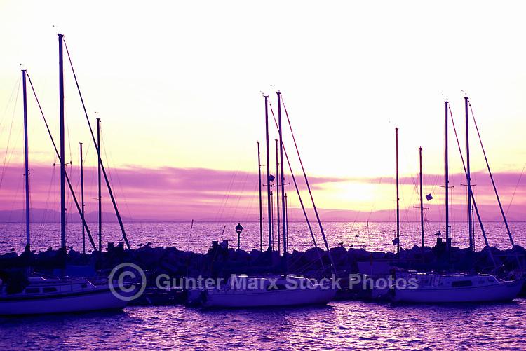 White Rock, BC, British Columbia, Canada - Sailboats docked at White Rock Pier in Semiahmoo Bay, Sunset