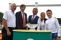 Connections of Robin Weathers receive their trophy after winning The CPA Scaffolding Maiden Stakes during Ladies Evening Racing at Salisbury Racecourse on 15th July 2017