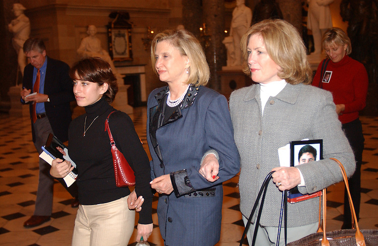 12/06/04.INTELLIGENCE REFORM BILL--Family members Carie Lemack, left, and Mary Fetchet, right, with Carolyn B. Maloney, D-N.Y., with other family members on their way through Statuary Hall to deliver a petition to House Speaker J. Dennis Hastert, R-Ill., urging him to schedule a vote on the intelligence reform bill before the imminent end of the 108th Congress. Family member Beverly Eckert is at background, right..CONGRESSIONAL QUARTERLY PHOTO BY SCOTT J. FERRELL