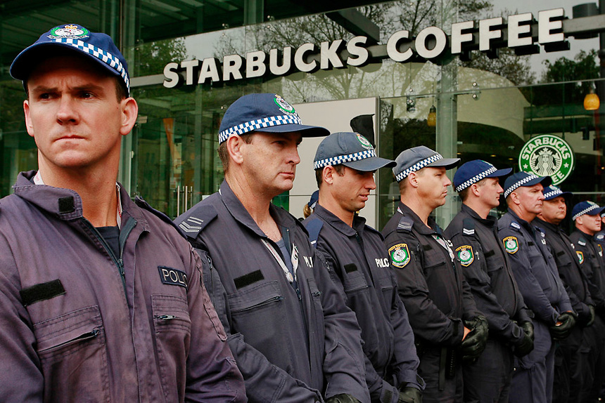 A line of police stand in front of a coffee shop during a protest against the 2007 APEC conference held in Central Sydney, September 8, 2007. Photo: Ed Giles.
