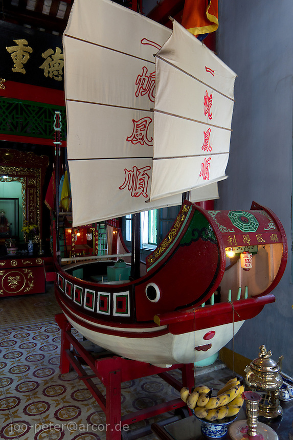 boat model in Phouc Kien Hoi Quan temple, assembly hall (called Hoi Quan) of the chinese ciommunity  in city Hoi An, Vietnam. The chinese community was closly coonected to the sea trade. Small offerings in the model boat er presented for good luck.