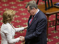 Former Quebec premier Lucien Bouchard gives his condolences to Lisette Lapointe, wife of former Quebec premier Jacques Parizeau, as her husband lies in state at the National Assembly in Quebec City on Sunday June 7, 2015.