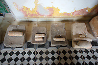 Mayan metates from the archaeological site of Yaxcopoil in tha Maya Room at Hacienda Yaxcopoil, Yucatan, Mexico.