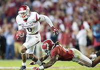 NWA Democrat-Gazette/JASON IVESTER <br /> Arkansas defensive back Santos Ramirez (9) slips away from Alabama running back Derrick Henry (2) after intercepting a pass in the second quarter on Saturday, Oct. 10, 2015, at Bryant-Denny Stadium in Tuscaloosa, Ala.