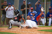 New York Mets outfielder Tim Tebow (15) slides into home where he is tagged out by catcher Pablo Garcia (5) during an Instructional League game against the Miami Marlins on September 29, 2016 at Port St. Lucie Training Complex in Port St. Lucie, Florida.  (Mike Janes/Four Seam Images)