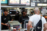 07/23/2015. McDonald's workers attend customers on a Restaurant in New York , the state fast food workers' wages will eventually rise to $15 (£9.60) an hour. Kena Betancur/VIEWpress