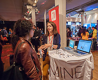 A representative from Findmine, a browser plug-in that personalizes merchandise and styles for users, explains the service at the Techweek expo in New York event on Thursday, October 15, 2015. Thousands of visionaries and entrepreneurs attended to network with established and start-up technology companies. (© Richard B. Levine)