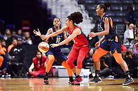 Washington, DC - June 3, 2018: Washington Mystics guard Kristi Toliver (20) passes out of a double team by Connecticut Sun guard Courtney Williams (10) and Connecticut Sun forward Jonquel Jones (35) during game between the Washington Mystics and Connecticut Sun at the Capital One Arena in Washington, DC. (Photo by Phil Peters/Media Images International)