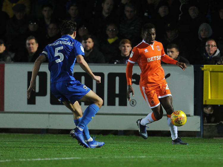 Blackpool's Marc Bola under pressure from AFC Wimbledon's Will Nightingale<br /> <br /> Photographer Kevin Barnes/CameraSport<br /> <br /> The EFL Sky Bet League One - AFC Wimbledon v Blackpool - Saturday 29th December 2018 - Kingsmeadow Stadium - London<br /> <br /> World Copyright © 2018 CameraSport. All rights reserved. 43 Linden Ave. Countesthorpe. Leicester. England. LE8 5PG - Tel: +44 (0) 116 277 4147 - admin@camerasport.com - www.camerasport.com