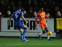Blackpool's Marc Bola under pressure from AFC Wimbledon's Will Nightingale<br /> <br /> Photographer Kevin Barnes/CameraSport<br /> <br /> The EFL Sky Bet League One - AFC Wimbledon v Blackpool - Saturday 29th December 2018 - Kingsmeadow Stadium - London<br /> <br /> World Copyright &copy; 2018 CameraSport. All rights reserved. 43 Linden Ave. Countesthorpe. Leicester. England. LE8 5PG - Tel: +44 (0) 116 277 4147 - admin@camerasport.com - www.camerasport.com