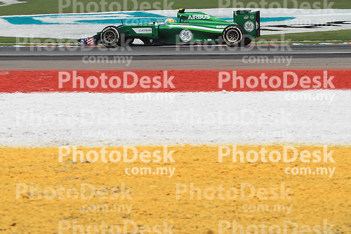 KUALA LUMPUR, MALAYSIA - MARCH 28: Caterham driver Marcus Ericsson of Sweden in action during the second practice session during the Malaysia Formula One Grand Prix at the Sepang Circuit on March 28, 2014 in Kuala Lumpur, Malaysia. (Photo by PETER LIM/PhotoDesk.com.my)
