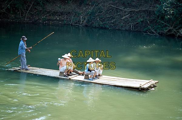 Tourists on bamboo raft, Mae Ping River, Mae Ping, near Chiang Mai, Northern Thailand