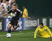 Jed Zayner#12 of D.C. United gets away from Dilly Duka#11 of the Columbus Crew during the opening match of the 2011 season at RFK Stadium, in Washington D.C. on March 19 2011.D.C. United won 3-1.