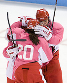 Taylor Holze (BU - 24), Jenn Wakefield (BU - 9), Isabel Menard (BU - 20) - The Boston University Terriers defeated the visiting Northeastern University Huskies 3-2 on Saturday, January 28, 2012, at Agganis Arena in Boston, Massachusetts.