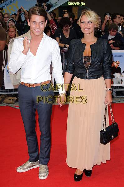 Joey Essex & Sam Faiers.'Larry Crowne' world film premiere, Vue cinema, Westfield, Shepherds Bush, London, England 6th June 2011.full length black leather jacket beige nude long maxi skirt couple bag white shirt holding hands grey gray trousers brown belt TOWIE chanel bag trainers gold .CAP/CJ.©Chris Joseph/Capital Pictures.