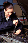 Teenagers in workplace  Auto repair.female student working on car engine