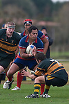 Amos Mataia looks to push off the tackle of Paul Ivamy. Counties Manukau Premier Club Rugby semi final game between Ardmore Marist & Pukekohe played at Bruce Pulman Park Papakura on Saturday July 19th 2008. Ardmore Marist won 18 - 15 & will meet Patumahoe in the final next weekend.