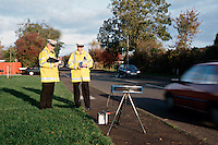 Traffic police officers performing speed enforcement checks using a  laser equiped speed measuring device called a mini gatso. The officers points the unit at  on-coming vehicles and the speed is shown on the back of the unit. ..© SHOUT. THIS PICTURE MUST ONLY BE USED TO ILLUSTRATE THE EMERGENCY SERVICES IN A POSITIVE MANNER. CONTACT JOHN CALLAN. Exact date unknown.john@shoutpictures.com.www.shoutpictures.com..