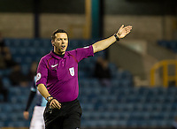 Referee Dean Whitestone during the Checkatrade Trophy round two Southern Section match between Millwall and Wycombe Wanderers at The Den, London, England on the 7th December 2016. Photo by Liam McAvoy.