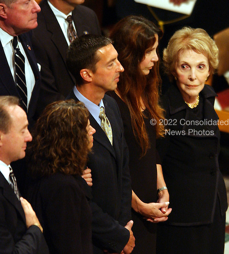 Former first lady Nancy Reagan, right, looks at her family at Ronald Reagan's funeral at the Washington National Cathedral in Washington, D.C. on June 11, 2004.   From left, Michael Reagan, Doria Reagan, Ron Reagan, Jr., Patty Davis, and Nancy Reagan.
