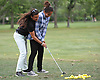 Kacie Mulligan, Assistant Pro at Lawrence Yacht and Country Club, left, helps Jasmine Arroyo, 14, of Lawrence, with her golf swing at the club's driving range on Tuesday, June 7, 2016.