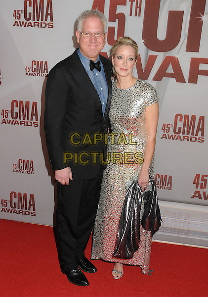 Glenn Beck & guest.The 45th Annual CMA Awards, Country Music's Biggest Night, held at Bridgestone Arena, Nashville, Tennessee, USA..November 9th, 2011.full length tuxedo suit silver dress blue black bow tie glasses.CAP/ADM/BP.©Byron Purvis/AdMedia/Capital Pictures.