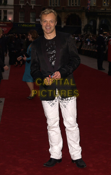 "GRAHAM NORTON.""Mission Impossible 3"" UK Film Premiere - Arrivals, Odeon Leicester Square, London, UK..April 25th 2006 .Ref: CAN.full length black jacket suit white jeans denim.www.capitalpictures.com.sales@capitalpictures.com.©Capital Pictures"